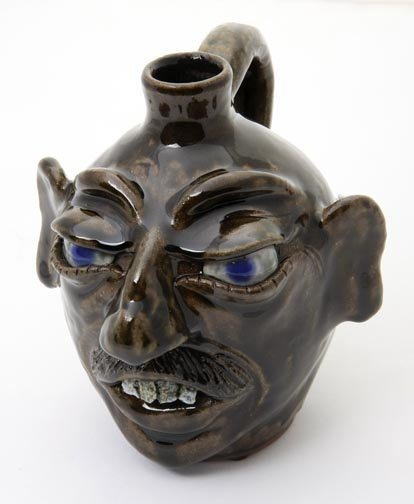 """56: Daniel Boone, """"face jug """"  Fired and glazed pottery"""