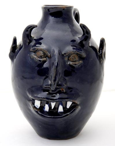 "61: Roger Hicks, ""Blue face jug"".   Fired and glazed po"