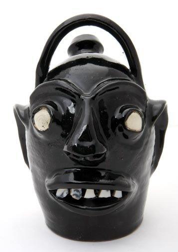 "63: Randy Tobias, ""Black Monkey"" Fired and glazed potte"