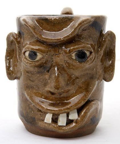 "70: Dwayne Craig- ""Face Mug"".  Fired and glazed pottery"