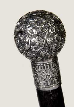 12: Sterling Dress Cane-Circa 1880-A high relief ball a