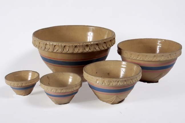 14: Five mixing bowls, minor chips on two rims, largest