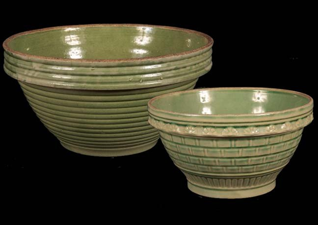 15: Mixing bowls, a pair of green salt glazed bowls in