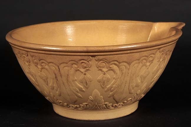 18: Large yellowware mixing bowl with spout, signed on