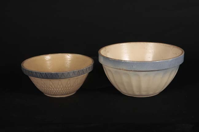 24: Two salt glazed mixing bowls in different patterns,