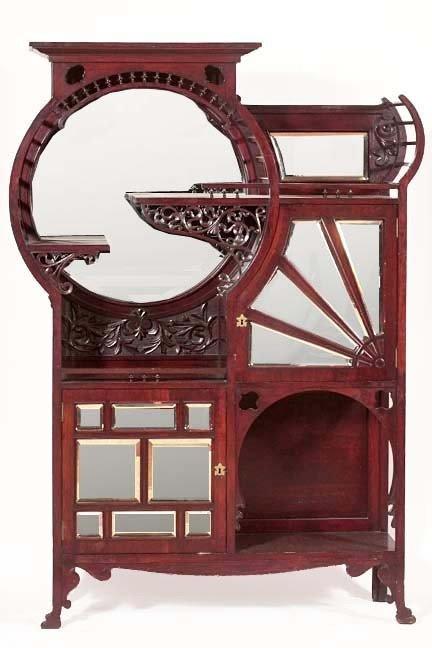 98: Art Nouveau high style Etagere  with a rich mahoga
