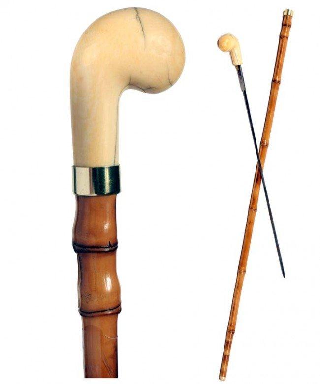 16: Ivory Sword Cane-Ca. 1875-A stylized ivory pistol g
