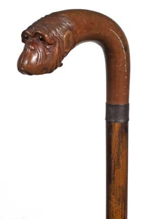 79: Articulated Monkey Cane-Circa 1885-A carved glove h