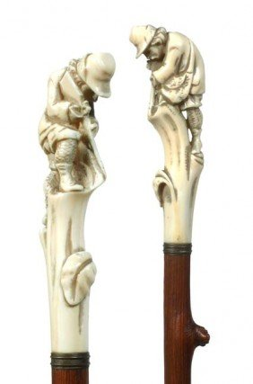11: Antique cane and  walking stick Ivory Hunter w/gun