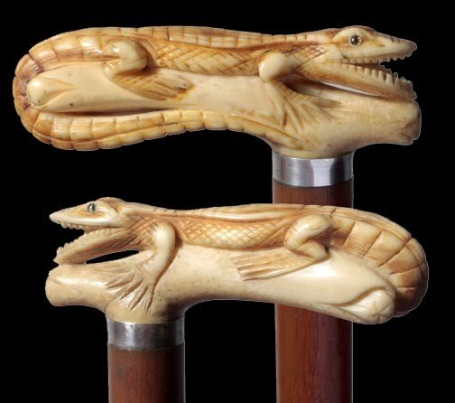22: 22. Ivory Reptile Cane-Circa 1900-Carved ivory hand
