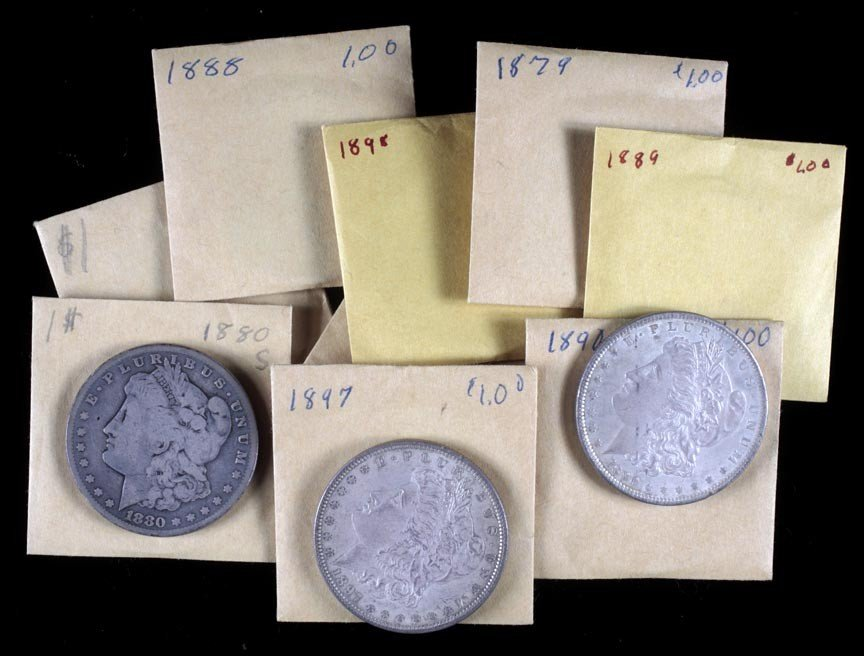 24. 10 Morgan silver dollars