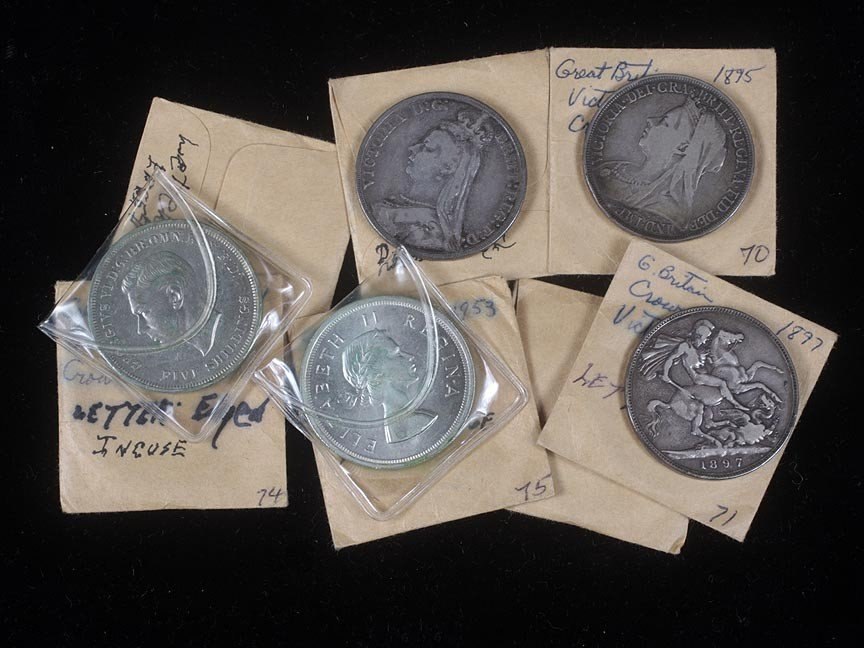 75. Lot of 7 silver English and South African coins