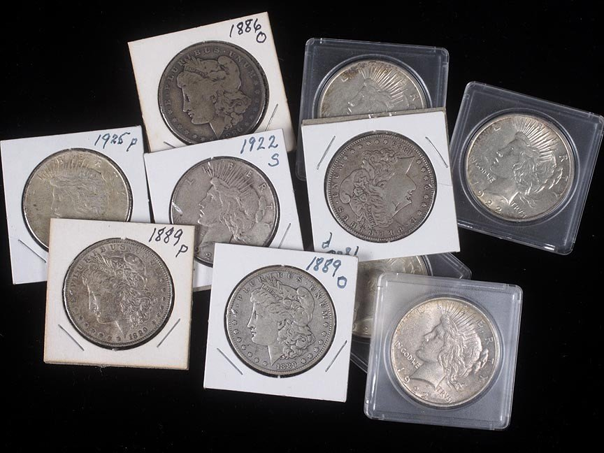 81. Ten mixed U.S. silver dollars
