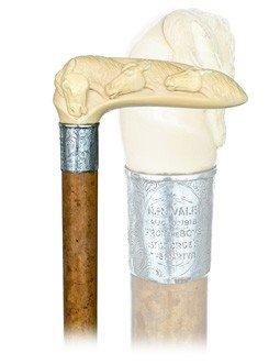 24: Ivory Three Stallion Heads Cane-London, dated 1918-