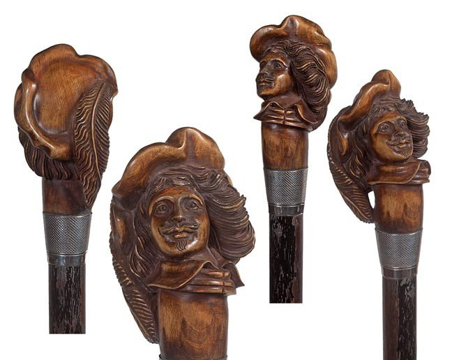 9: 9. Carved Cavalier Cane-Dated 1927-A finely carved f