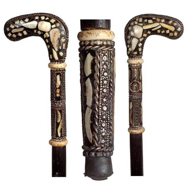 87: 87. Moroccan Dagger Cane- Circa 1935-A bone inlayed