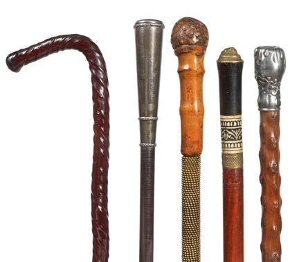 162. Group of Five Canes Including a Compartment Cane,