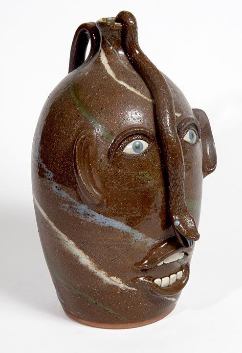 Southern Folk Pottery-Joe Rein-Swirl face jug with snak