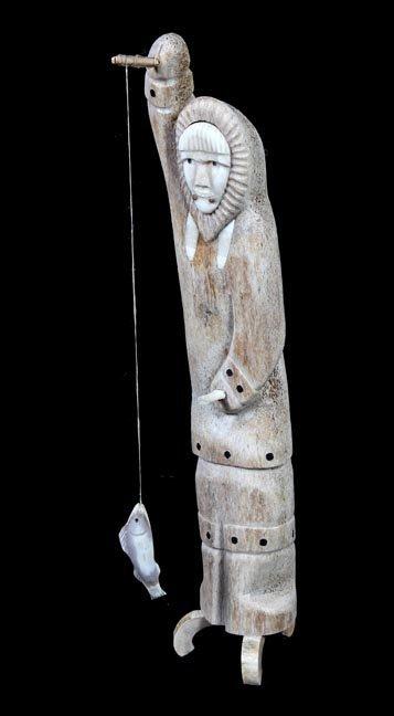 229. Eskimo Art, Ca. 1950, bone and ivory fisherman,