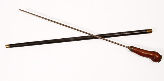 8. Exotic Wood Sword Cane- Ca. 1920- An exotic massive