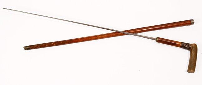 10. Horn Sword Cane- Ca. 1880- A polished horn handle,