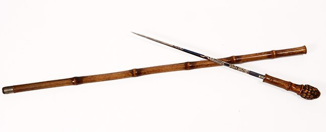 22. Asian Sword Cane- Ca. 1920- A well patinated bamboo