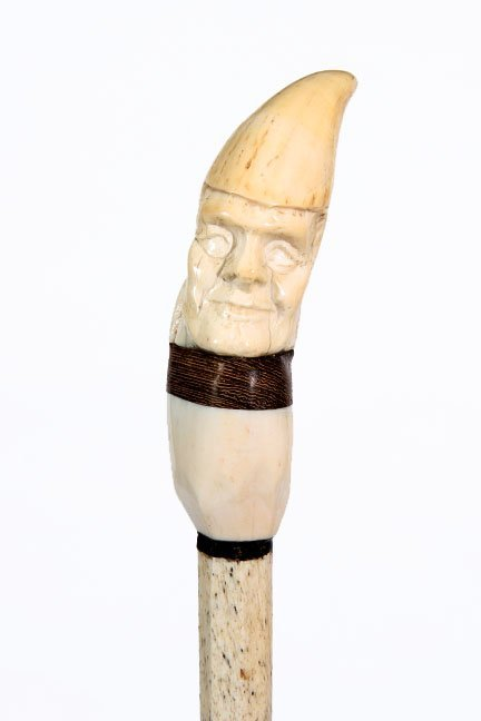 5. Nautical Tooth and Bone Cane- A carved whale's tooth