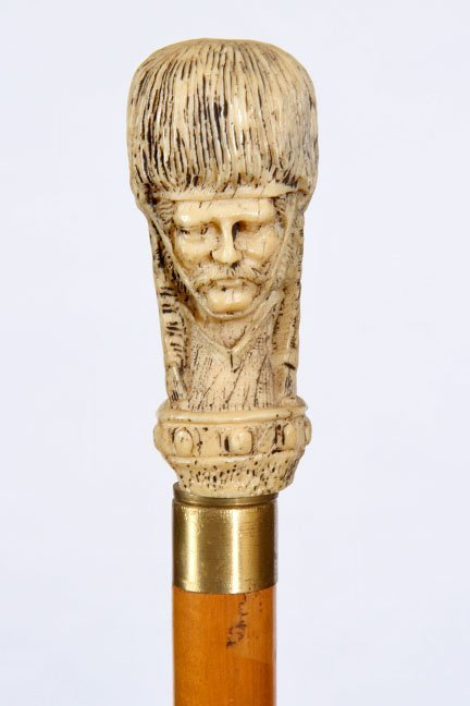 22. Soldier Portrait Cane- 20th Century- A cast resin