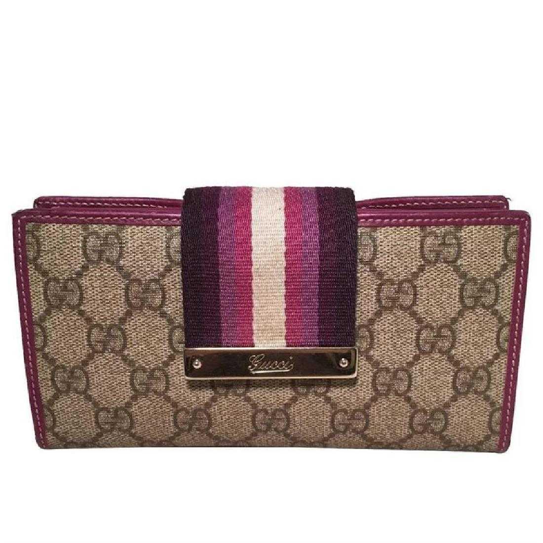 cb89f21dd62f Gucci Monogram Purple Striped Canvas Wallet