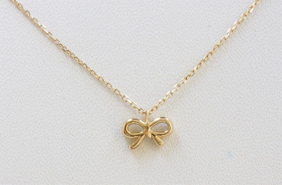 14K YELLOW GOLD BOW PENDANT WITH
