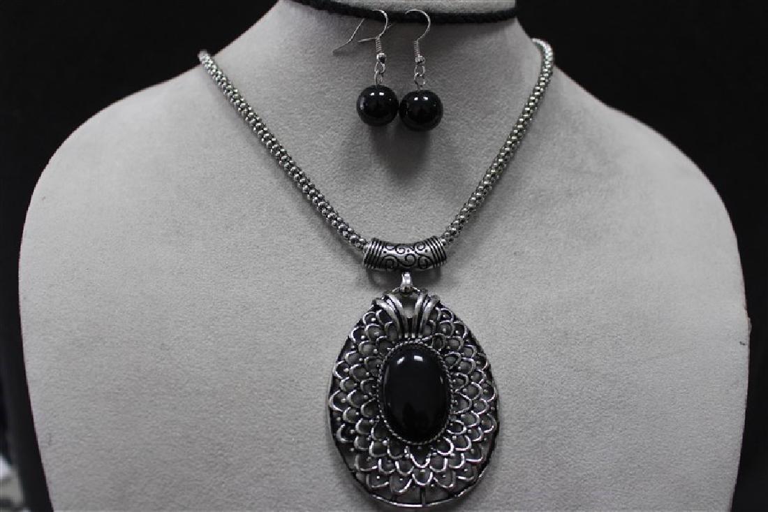 N+E Rhodium Jewelry