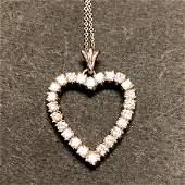 14 k white gold diamond heart pendant