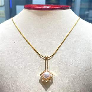 14k yellow gold chain and pendant with an 8.5mm akoya