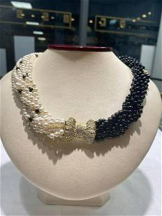 8 strands of 4-4.5mm akoya pearls and black onyx, 14k