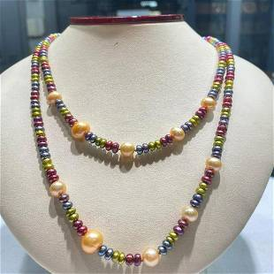 """36"""" of multi color pearls and fresh water pearls with a"""