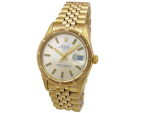34mm Rolex 14K Yellow Gold Oyster Perpetual Date Watch.