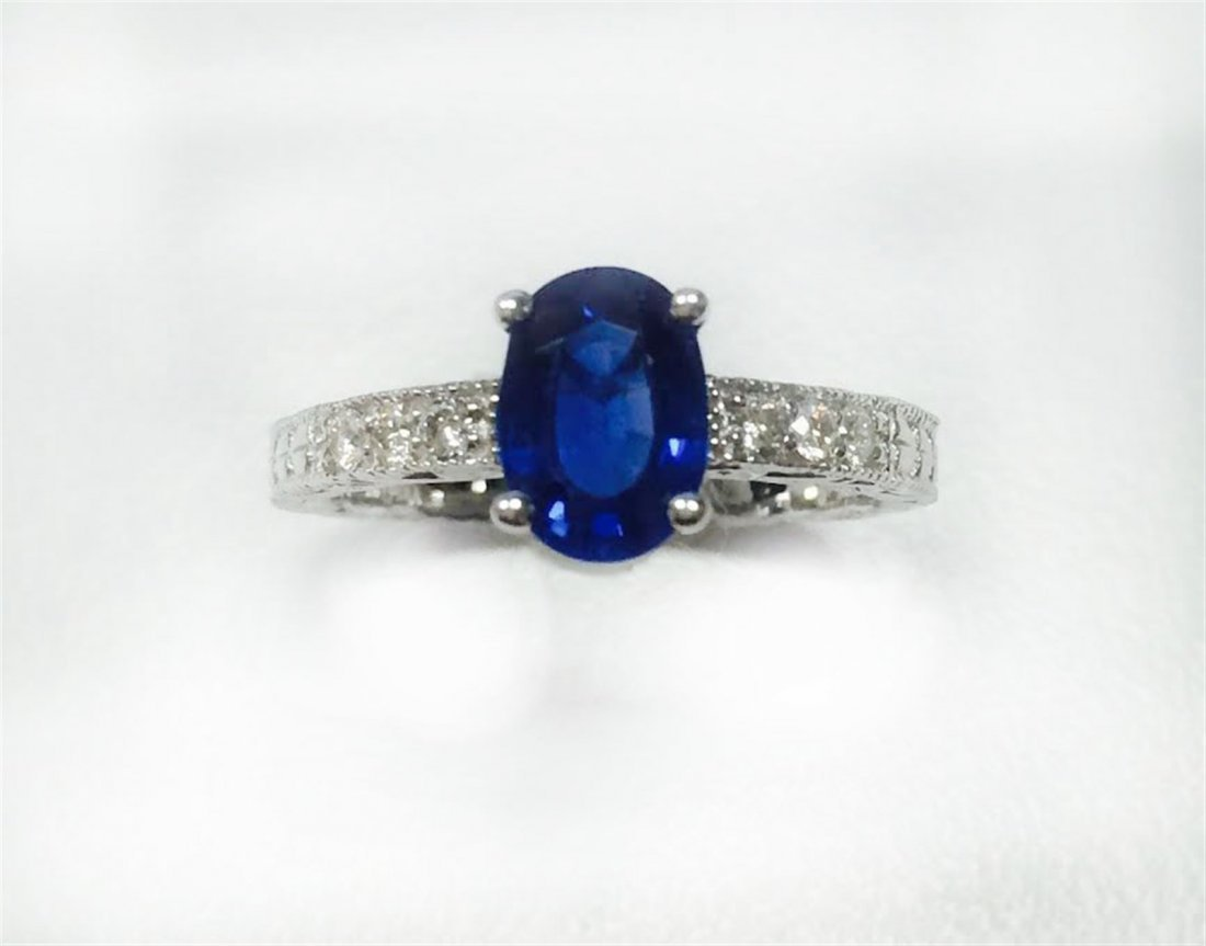 BLUE SAPPHIRE OVAL 1.65CT, 14K W/G RING 3.05GRAM /