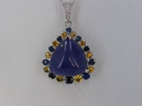 Cabochon Tanzanite 34.67 Ctw, Yellow And Blue Sapphire