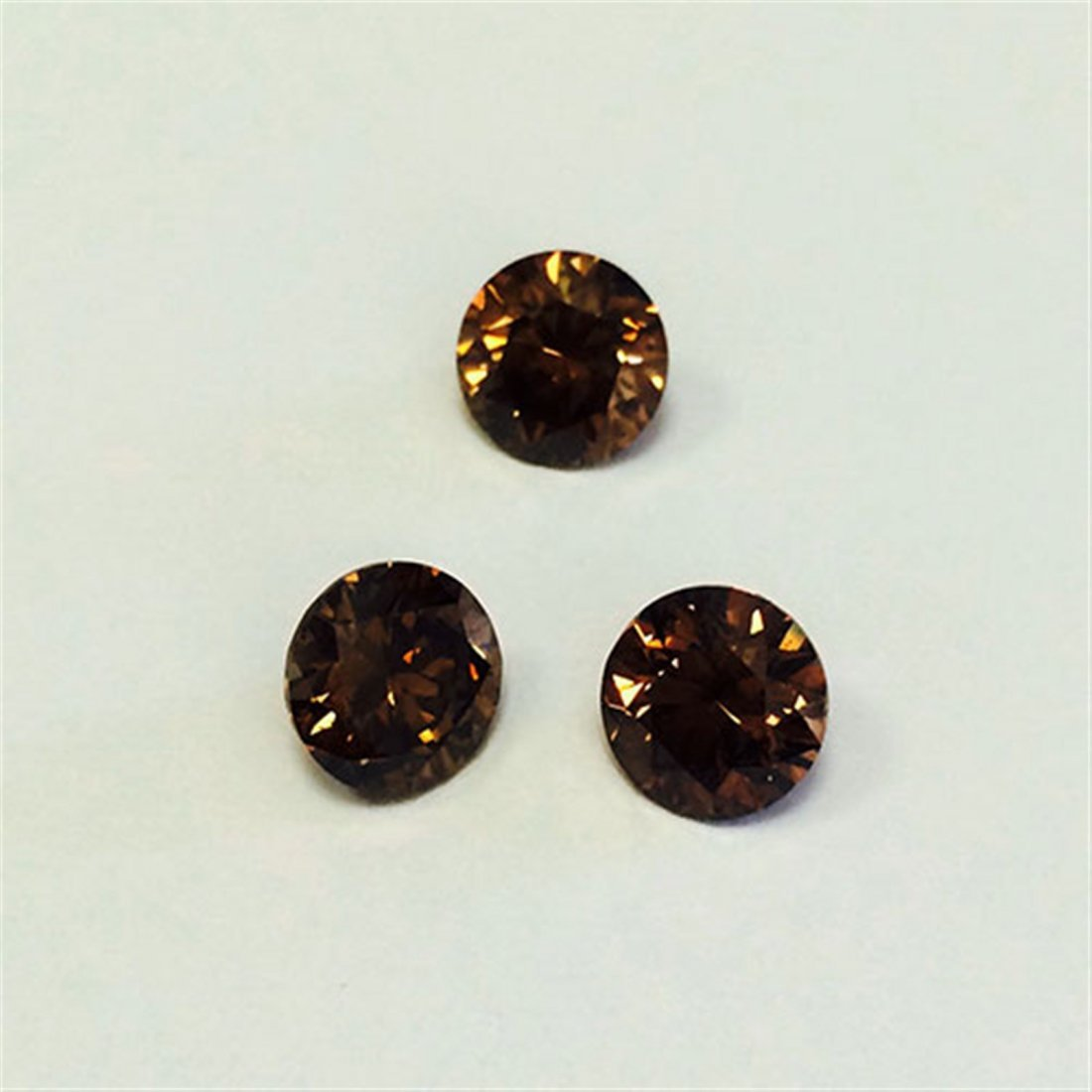 6 ct & up Fancy Dark Brown Round Brilliant  SI Good Cut