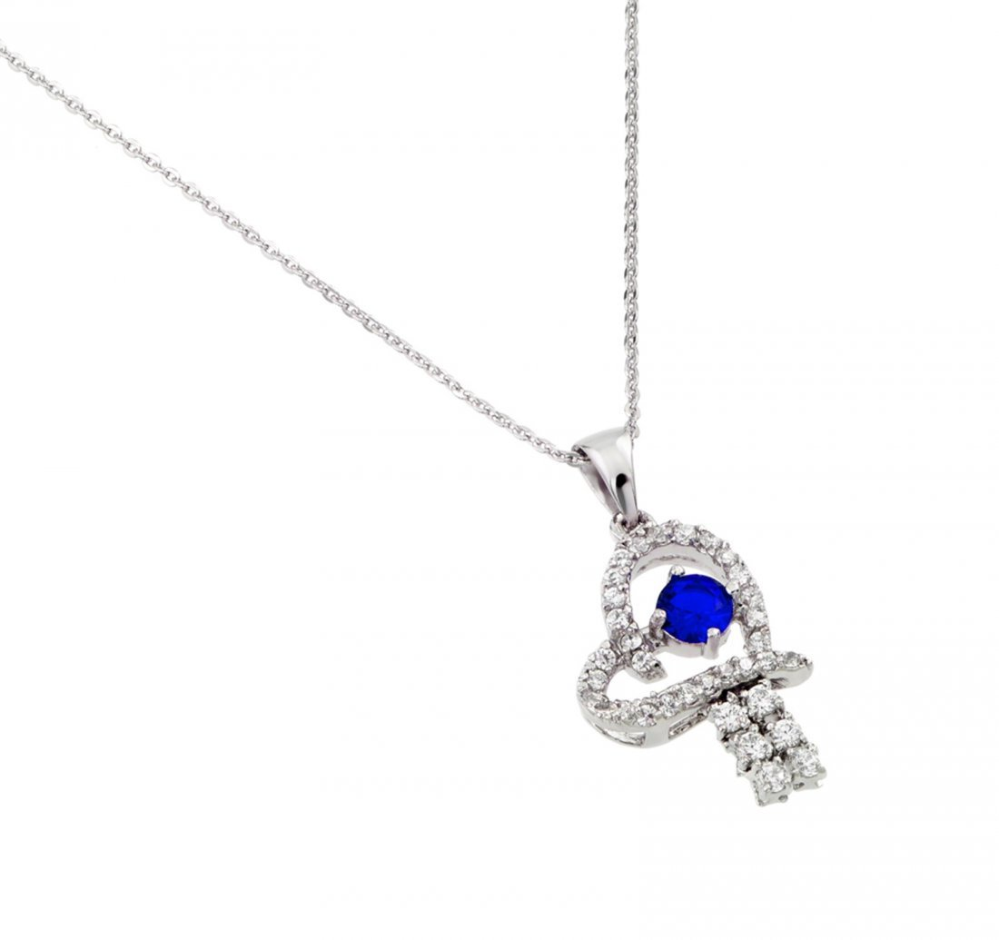Sterling Silver Rhodium Plated Blue CZ Heart Pendant