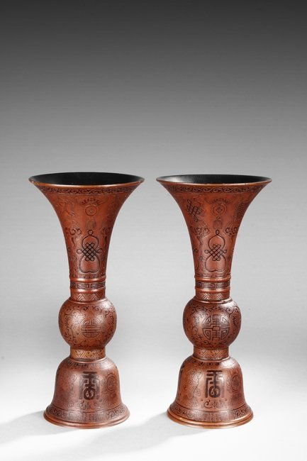 A Pair of gourd carved vases huagu