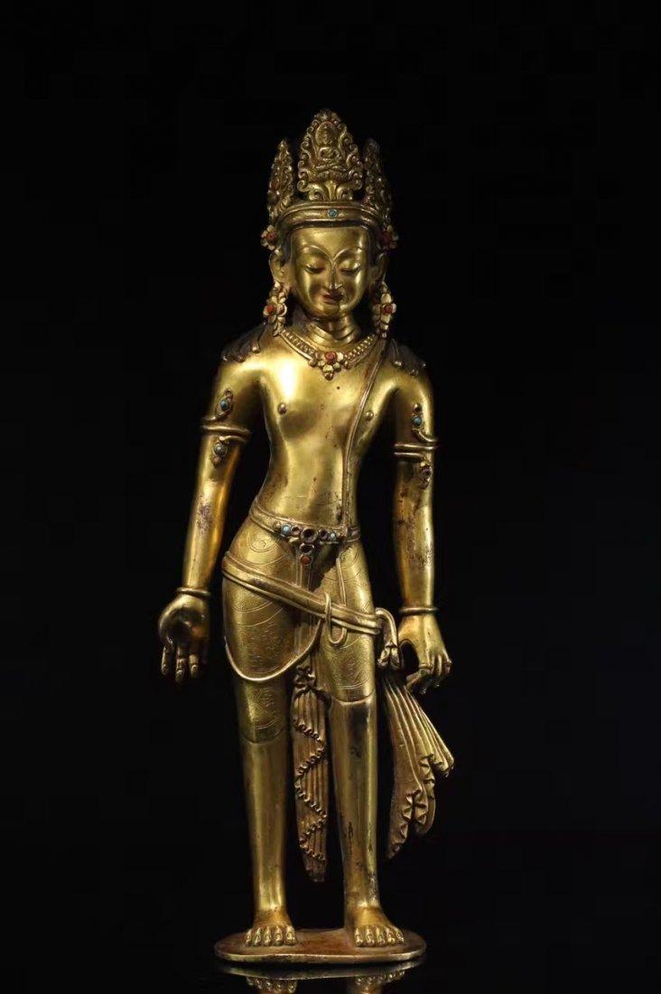 A Gilt-bronze figure of sakyamuni buddha