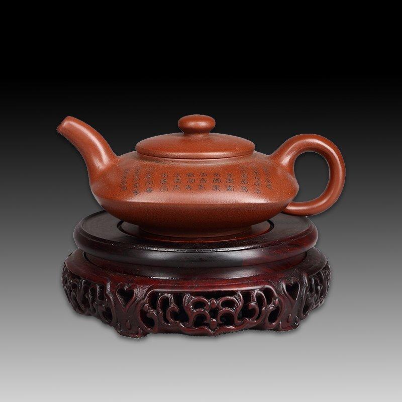 Chinese zisha teapot and cover.(Mark of Gu jingzhou)
