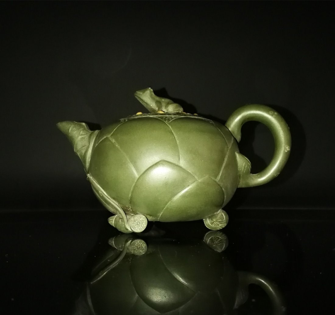 Chinese zisha teapot and cover.(Mark of Jiang Rong)