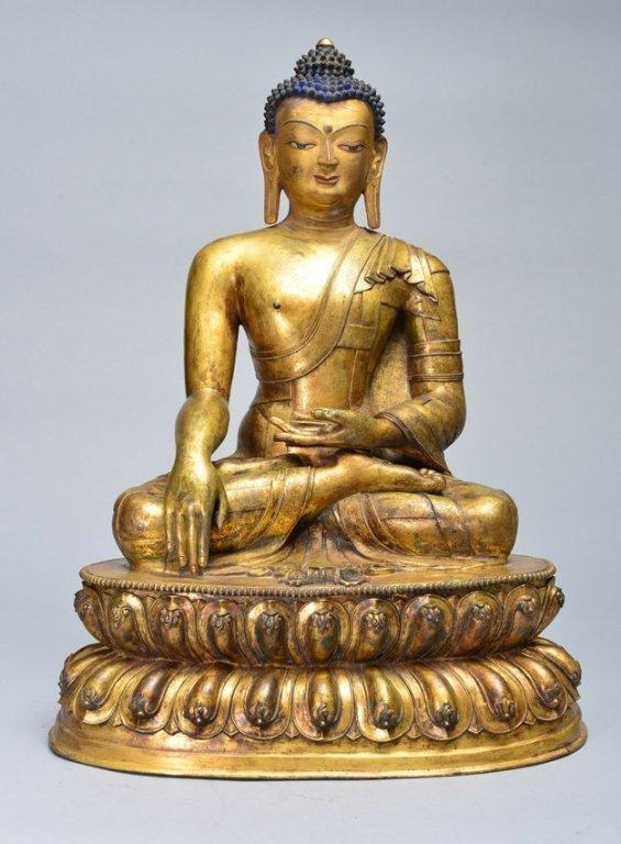 A LARGE GILT-BRONZE FIGURE OF SAKYAMUNI BUDDHA