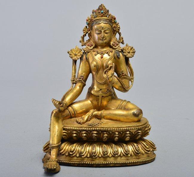 A Gilt-bronze figure of tara