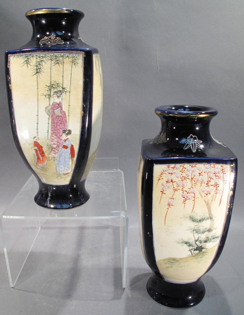 PAIR OF ORIENTAL VASES.  Navy blue with four panels of
