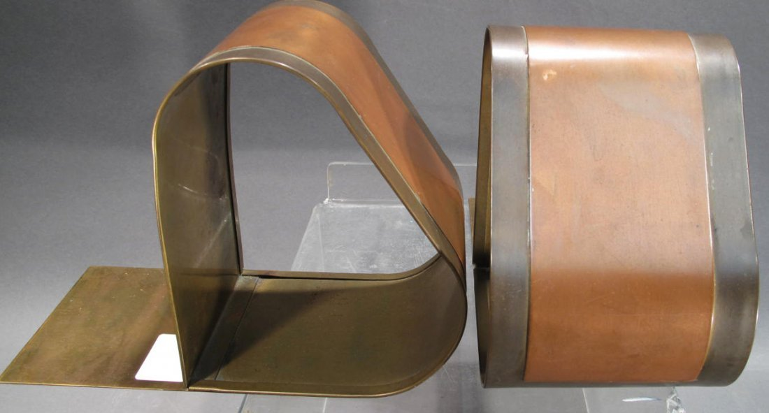 PAIR OF MODERN COPPER AND BRASS BOOKENDS.