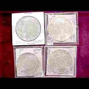 Four 1934 Peace Silver Dollars