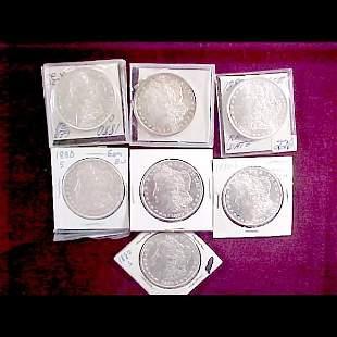 Seven (7) 1880 Morgan Silver Dollars